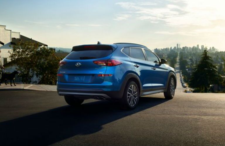 Exterior side and rear of the 2021 Hyundai Tucson as it is parked outside