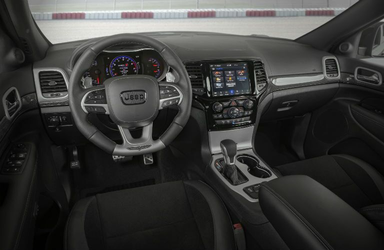 Interior front row driver seat area of the 2021 Jeep Grand Cherokee