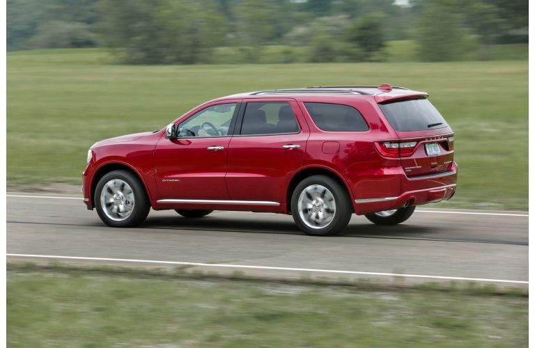 2020 Dodge Durango Citadel AWD exterior side shot with red paint color parked on a country road near fields of grass