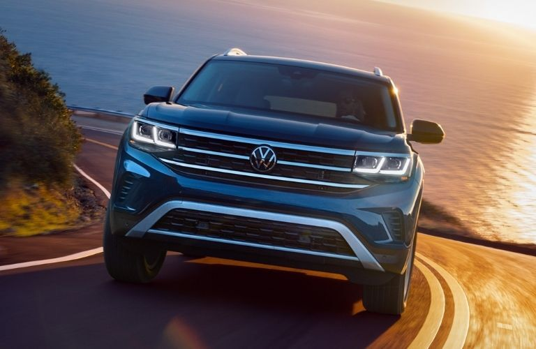 Exterior view of the front of a blue 2021 Volkswagen Atlas
