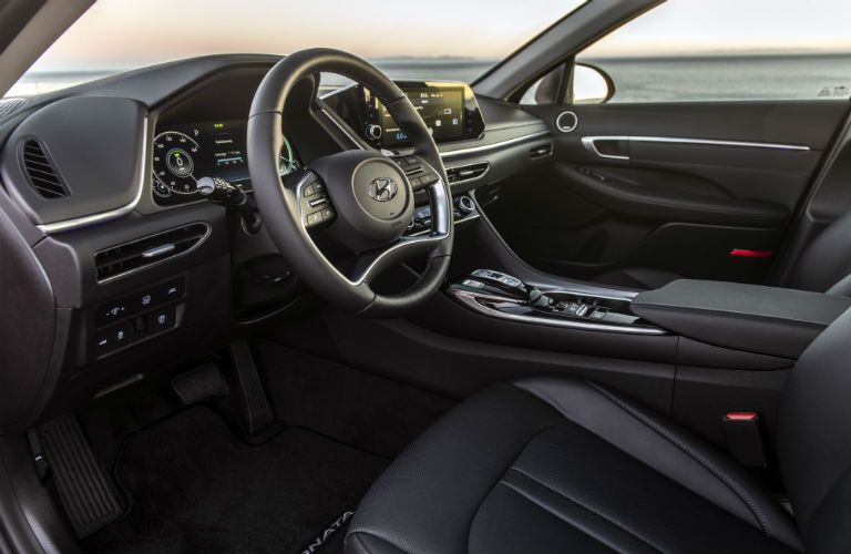 A front interior image of a 2020 Hyundai Sonata in a dark interior color combination.