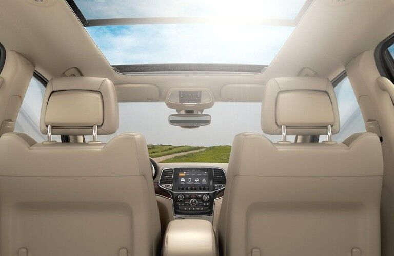 The sunroof and backs of the front row seats as seen from the second row of the 2021 Jeep Grand Cherokee