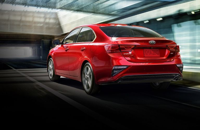 Exterior view of the rear of a red 2020 Kia Forte
