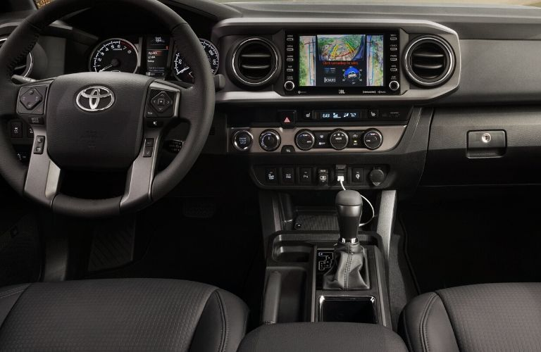 Interior view of the front seating area inside a 2020 Toyota Tacoma