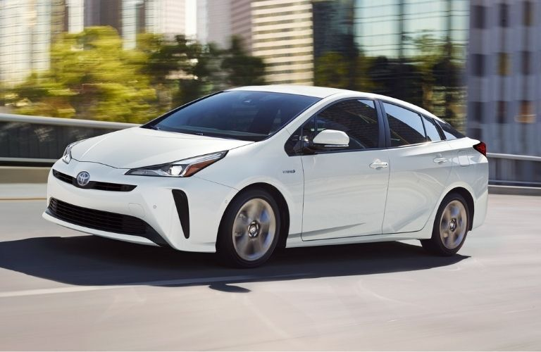 Exterior view of the front of a white 2021 Toyota Prius