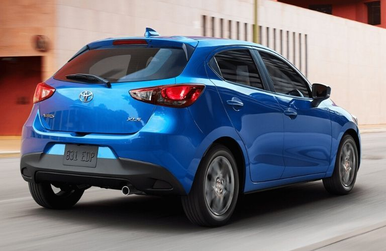 Exterior view of the rear of a blue 2020 Toyota Yaris Hatchback