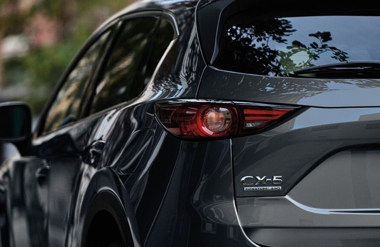 Exterior view of the rear taillight on a gray 2020 Mazda CX-5