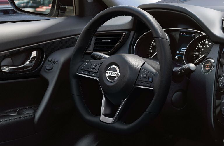 Close up of the black steering wheel in the 2019 Nissan Rogue