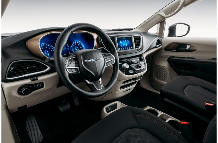 2020 Chrysler Voyager interior shot of front seating, controls, and dashboard layout