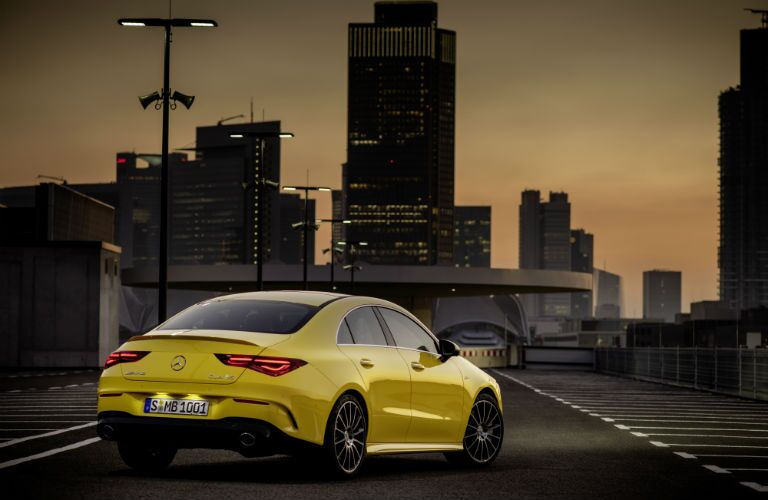 2020 MB CLA exterior back fascia passenger side in city at night