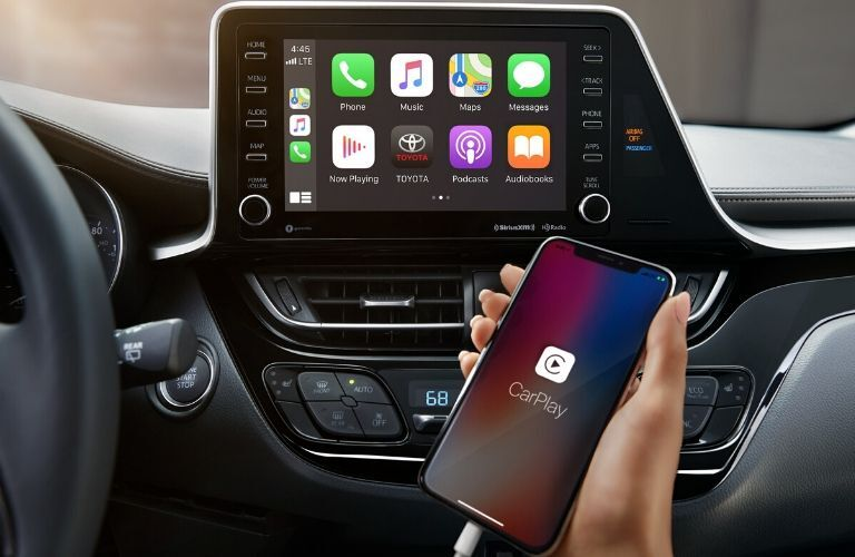 Apple CarPlay touchscreen and smartphone inside the 2020 Toyota C-HR