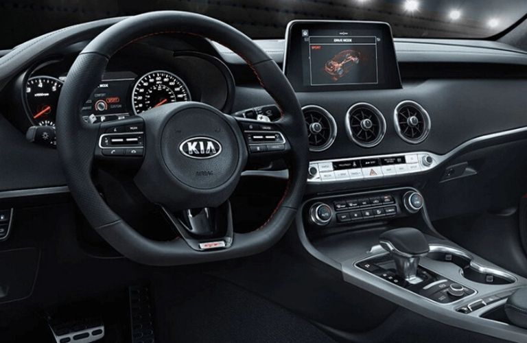 Interior view of the steering wheel and touchscreen display inside a 2020 Kia Stinger