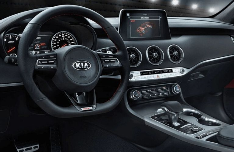 Interior view of the steering wheel and touchscreen inside a 2021 Kia Stinger