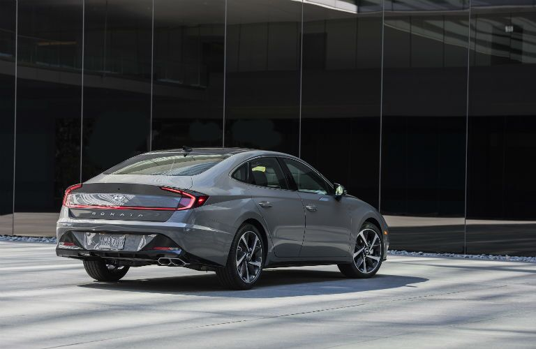 The rear and side view of a gray 2021 Hyundai Sonata.
