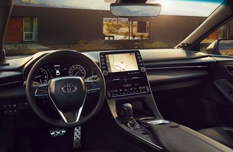 Interior view of the front seating area inside a 2020 Toyota Avalon