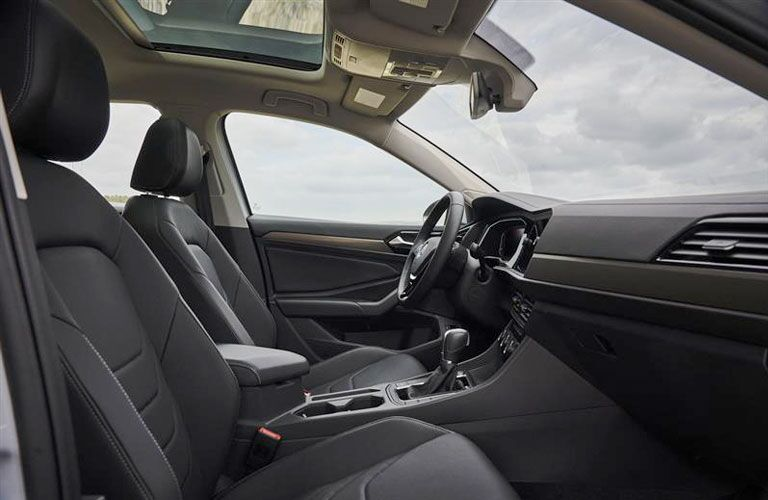 Interior view of the front seating area inside a 2020 Volkswagen Jetta