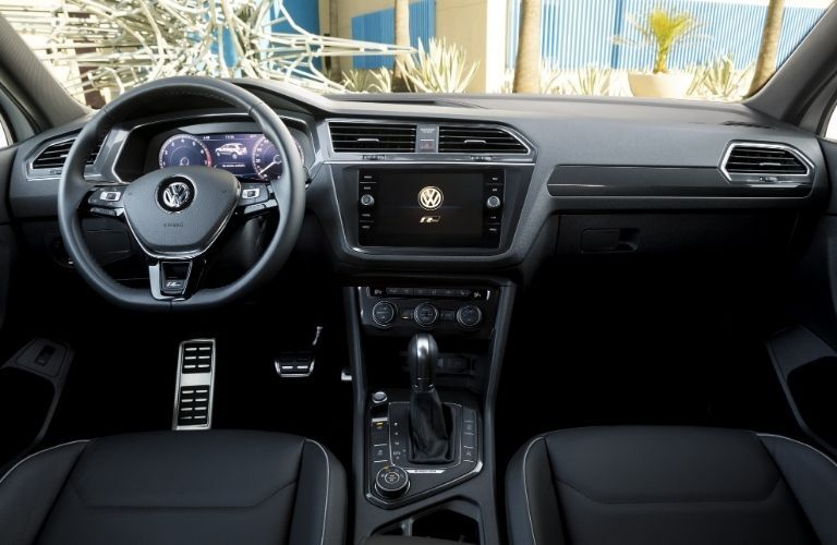 Interior view of the steering wheel and touchscreen display inside a 2020 Volkswagen Tiguan