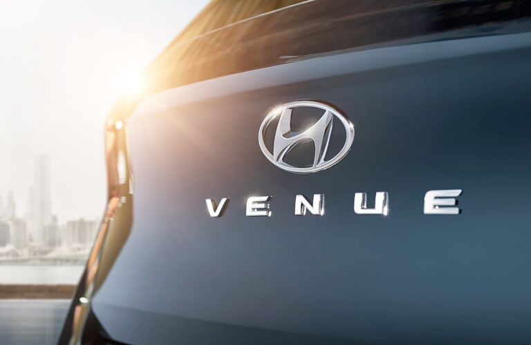 The Hyundai logo with the Venue tag on the back of a 2020 Hyundai Venue.