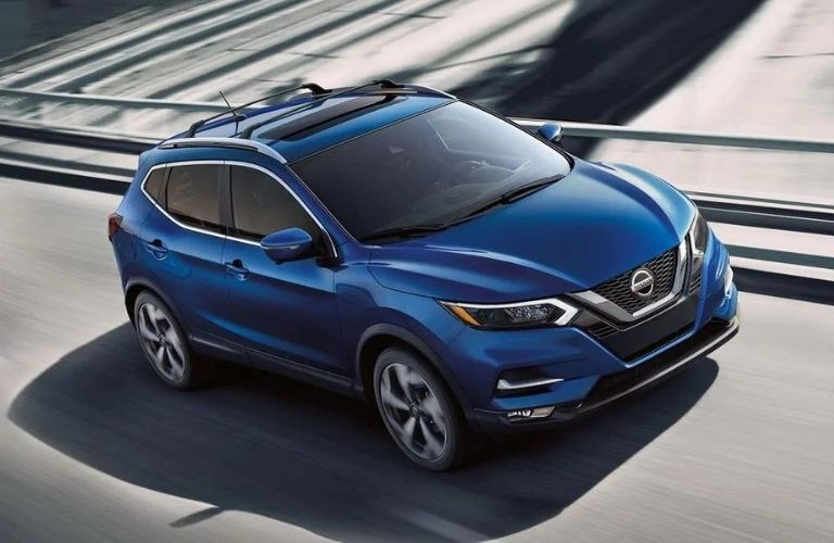 Exterior view of the front of a blue 2020 Nissan Rogue Sport