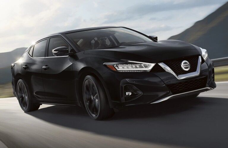 Front passenger angle of a black 2020 Nissan Maxima SR