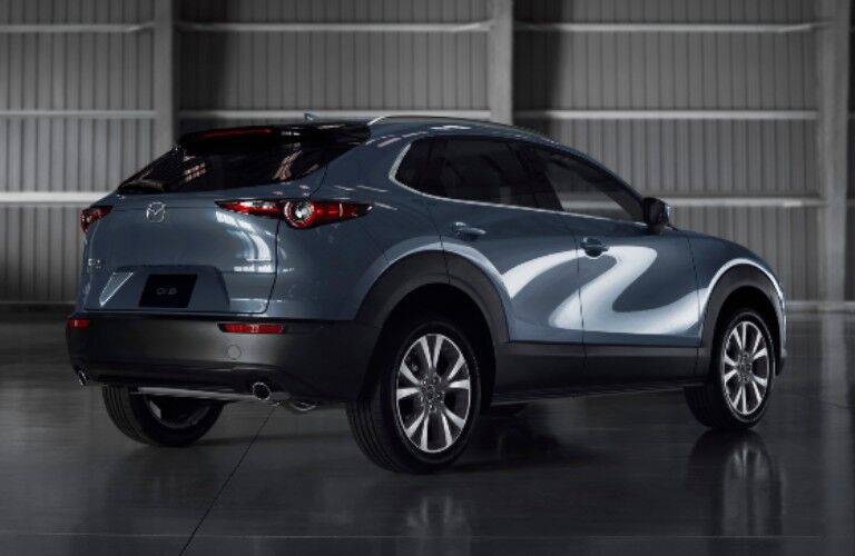 Exterior view of the rear of a blue 2020 Mazda CX-30