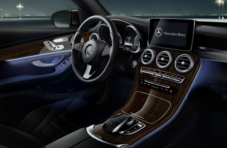 An interior photo of the driver's cockpit in the 2018 Mercedes-Benz GLC SUV.