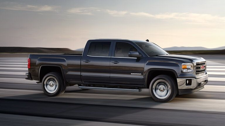 2014 GMC Sierra 1500 driving on the road
