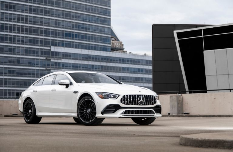 2021 MB AMG GT Coupe exterior front fascia passenger side in front of city