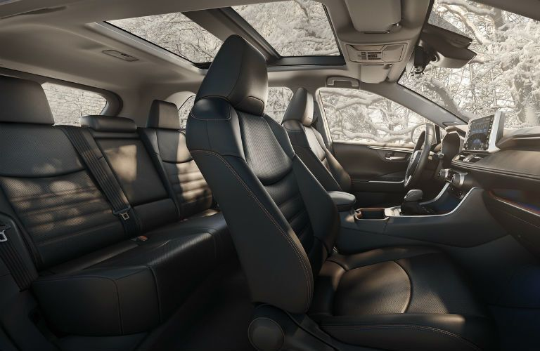 A photo of the front and back seats in the 2020 Toyota RAV4.