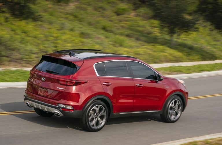 2020 Kia Sportage driving by grass