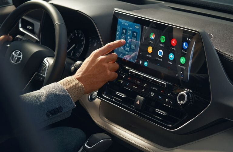 driver using touchscreen in the 2020 Toyota Highlander