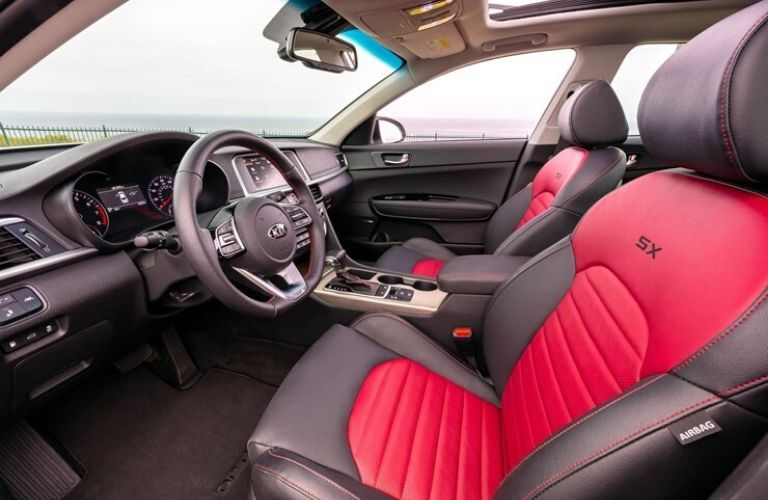 Dashboard and red and grey front seats in 2020 Kia Optima