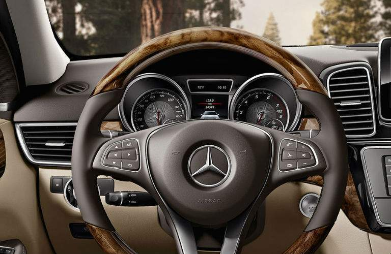 A photo showing the steering wheel and center gauge cluster in the 2018 Mercedes-Benz GLE 350.