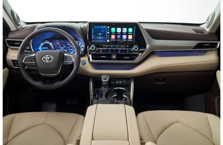 2020 Toyota Highlander redesigned SUV interior shot of front seating, steering wheel, and dashboard design with infotainment