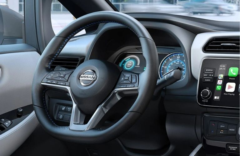 Interior view of the steering wheel inside a 2020 Nissan LEAF