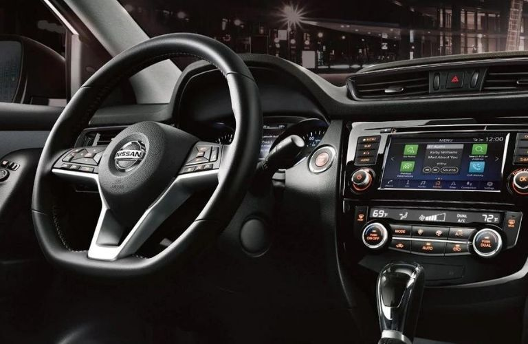 Interior view of the steering wheel and touchscreen display inside a 2020 Nissan Rogue Sport