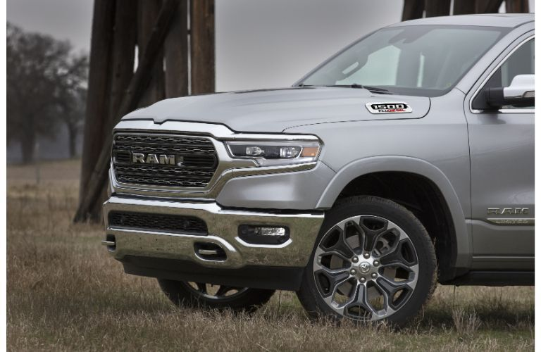 2020 Ram 1500 EcoDiesel exterior closeup side shot with gray metallic paint color of front end, grille, tire, and wheel