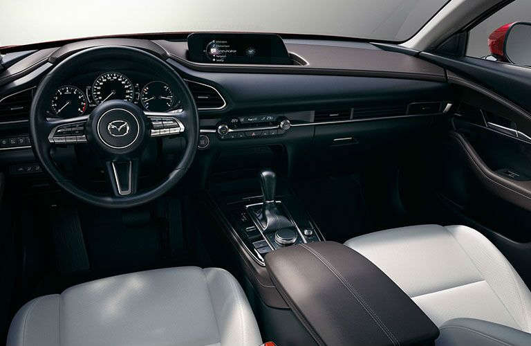 The front dashboard view inside a 2020 Mazda CX-30.