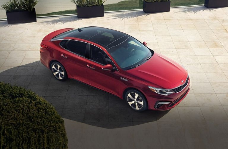 Exterior view of a red 2020 Kia Optima