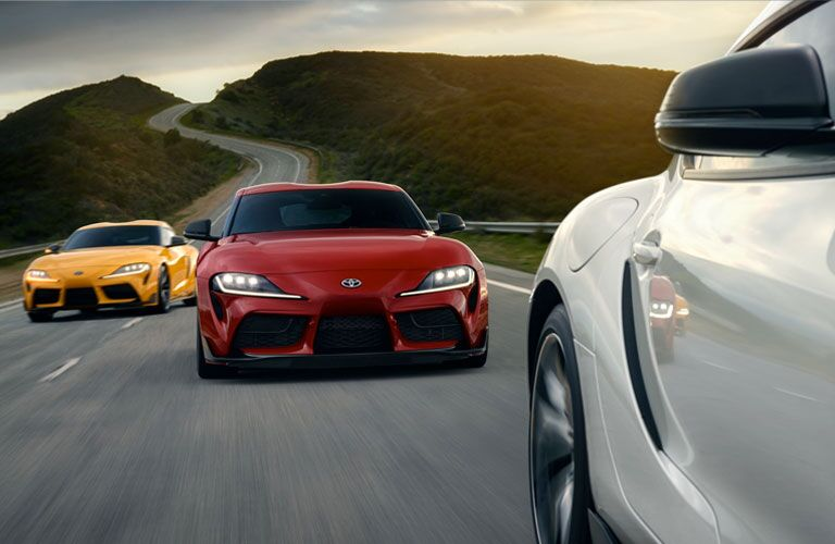 2020 Toyota GR Supra racing two other Supra cars