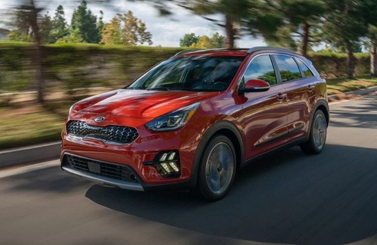 Exterior view of the front of a red 2020 Kia Niro