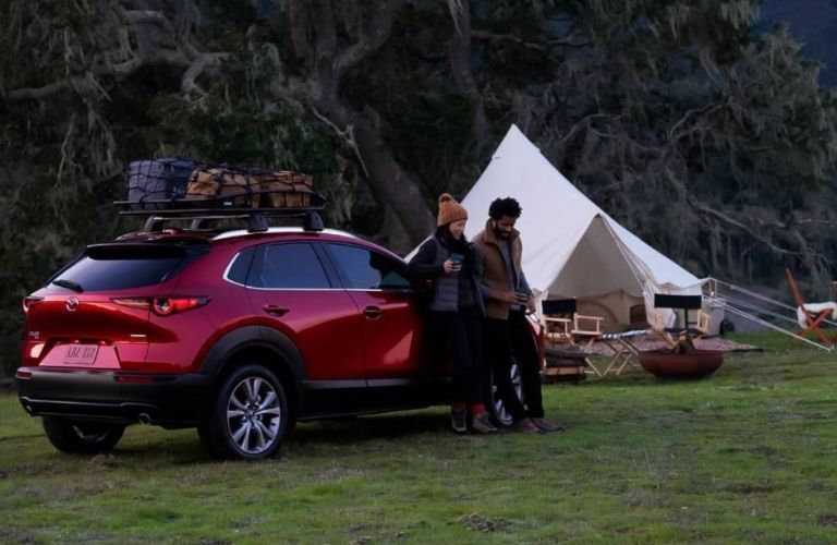 2021 Mazda CX-30 parked by tents
