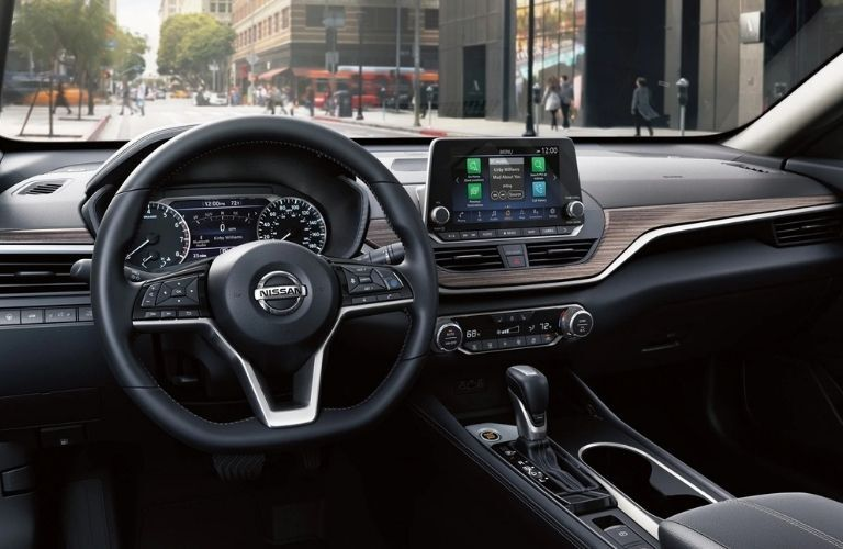 Interior view of the steering wheel and touchscreen display inside a 2020 Nissan Altima