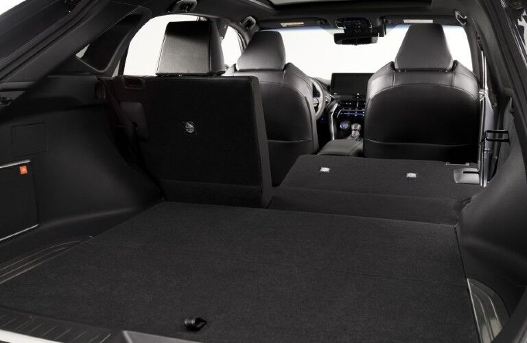 Part of second row of seats folded down inside of the 2021 Toyota Venza