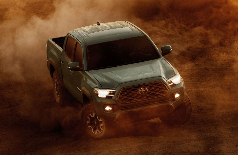 A photo of the 2021 Toyota Tacoma going through the desert.