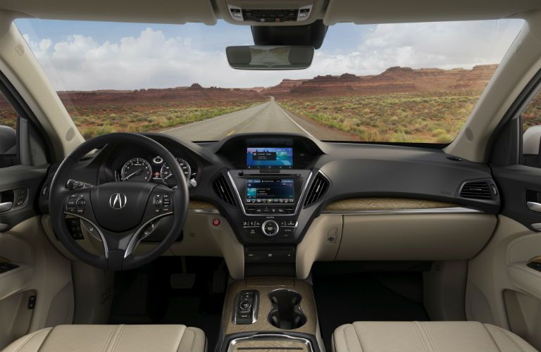 A photo of the dashboard and all of the features contained within for the 2020 Acura MDX.