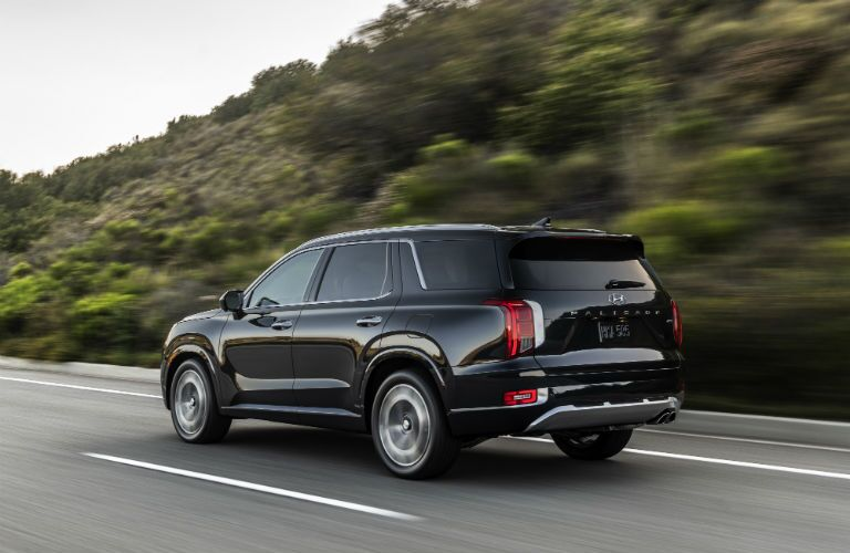 A rear left quarter photo of the 2021 Hyundai Palisade.