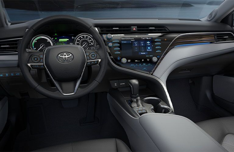 The front interior inside a 2021 Toyota Camry Hybrid.
