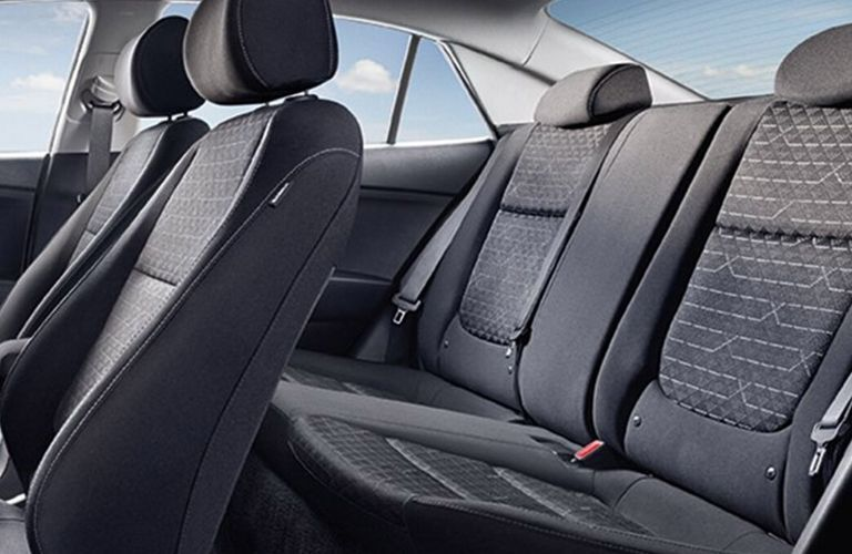 Interior view of the rear seating area inside a 2020 Kia Rio