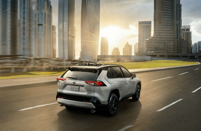 Silver 2020 Toyota RAV4 Rear Exterior on a Freeway